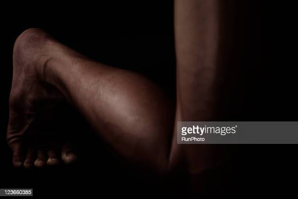 young muscular man,legs close-up - muscular build stock pictures, royalty-free photos & images