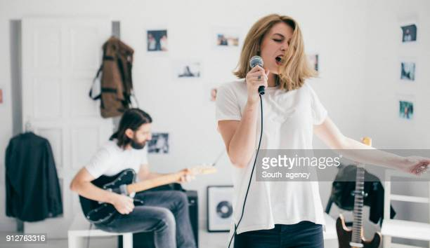 young music couple having rehearsal - the weekend singer stock pictures, royalty-free photos & images