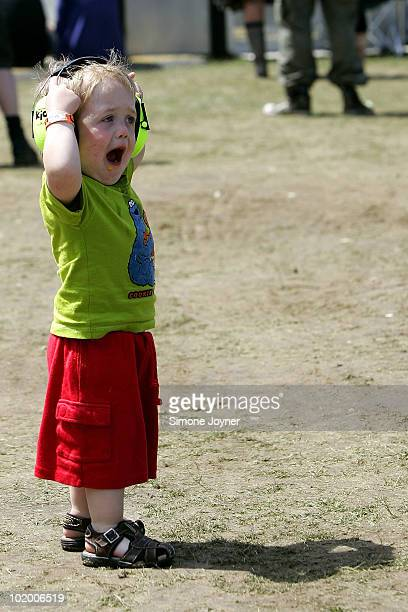 A young music fan wears ear defenders during day two of the Isle of Wight Festival 2010 at Seaclose Park on June 12 2010 in Newport Isle of Wight The...