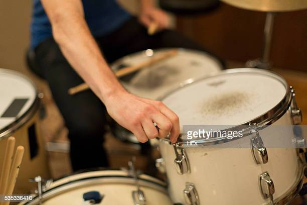 Young musician drumming
