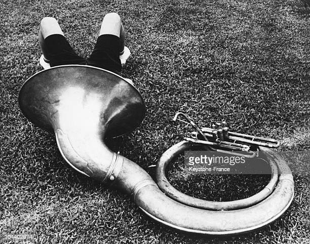 A young musician from the marching band of Miami University Florida taking a break in his instrument