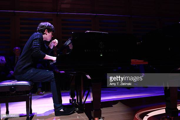 Young Musician of the Year 2014 Martin James Bartlett rehearses at a Steinway piano before a performance of 'Word And Play Celebrity Christmas Gala'...