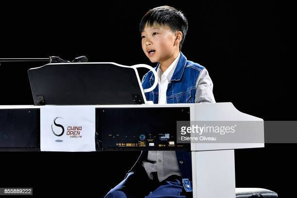Young musician performs at the opening ceremony of the 2017 China Open at the China National Tennis Centre on September 30, 2017 in Beijing, China.