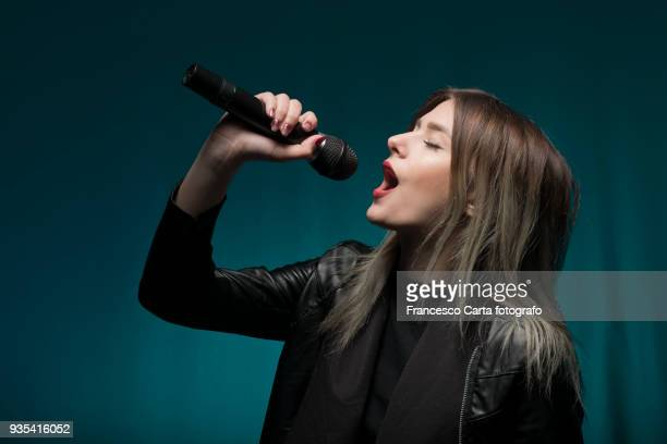 young musician - singer stock pictures, royalty-free photos & images