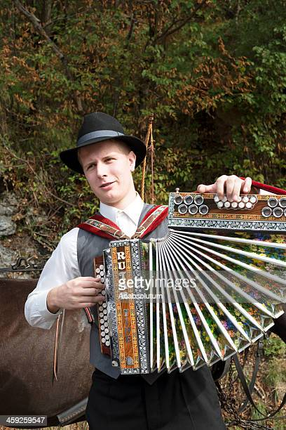 young musician playing accordion slovenia - folk stock photos and pictures