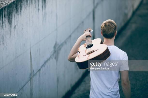 young musician with guitar - músico imagens e fotografias de stock