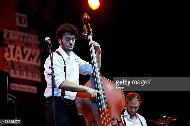 young musicians at free open air concert in montreal - double bass stock photos and pictures