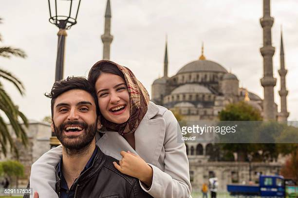 young muslim couple at the blue mosque, istanbul, turkey - muslim couple stock pictures, royalty-free photos & images