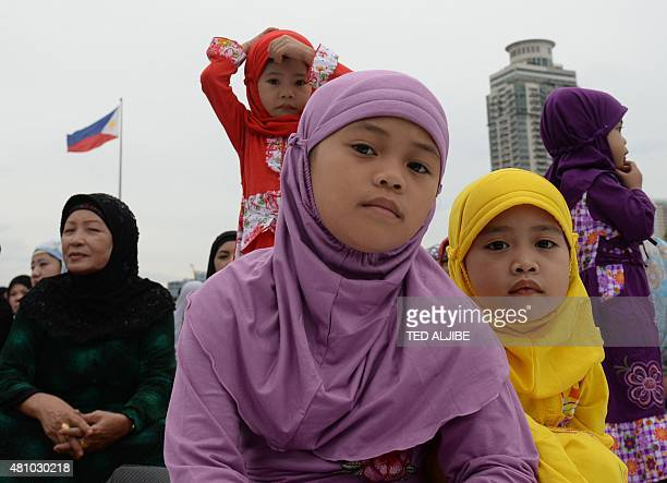 Young Muslim devotees attend Friday prayers with their mothers to mark the end of the holy month of Ramadan and the start of Eid alFitr at a park in...