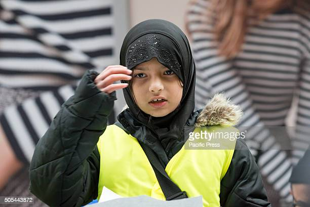 A young Muslim girl among the demonstrators leads the crowd with an opening invocation Nearly 1000 members of the MuslimAmerican community from New...