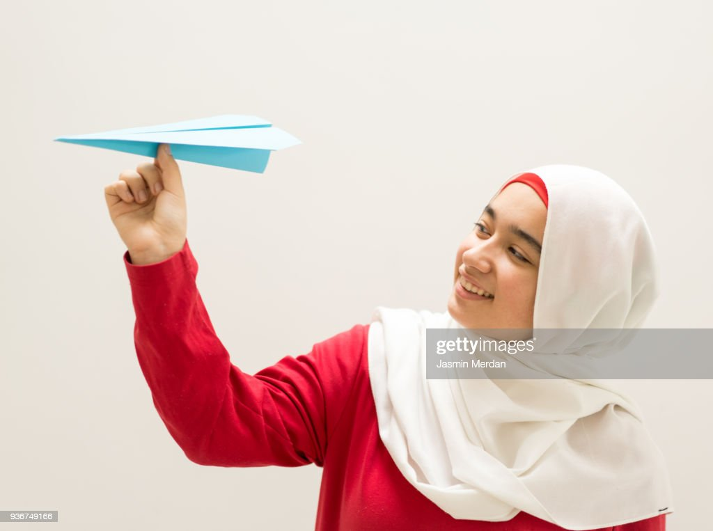 Young Muslim Girl Holding Paper Airplane : Stock Photo