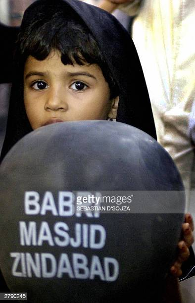 A young Muslim girl holds a black balloon with the message Babri Masjid Zindabad in her hands during a march along Mohammed Ali Street in Bombay06...
