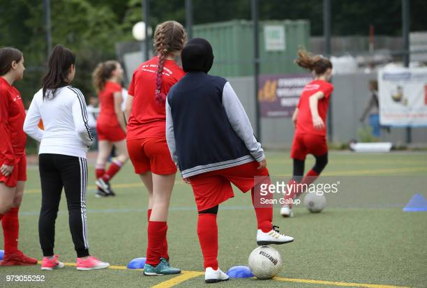A young Muslim girl wearing a headscarf participates in a training day in a program to encourage integration of children with foreign roots through...