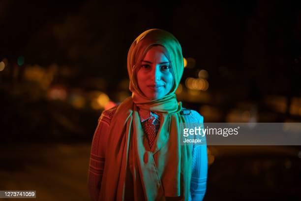 young muslim girl with hijab posing for a portrait outdoor ay night - islam stock pictures, royalty-free photos & images