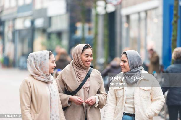 young muslim girlfriends - minority groups stock pictures, royalty-free photos & images