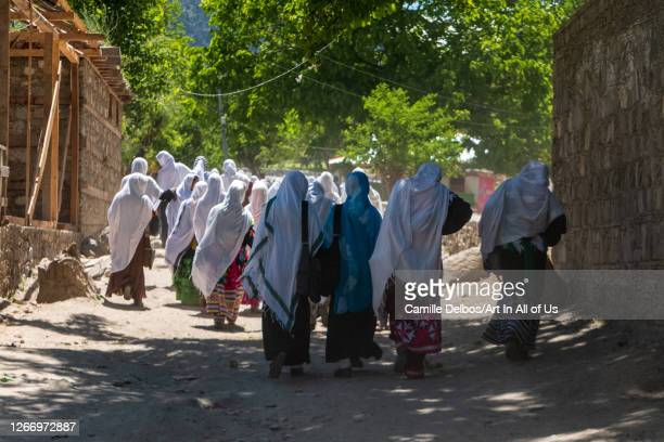 Young Muslim girls and Kalash going together to school. The polytheistic Kalashs and the Pakistani Muslims live together in the same valleys. On Mai...