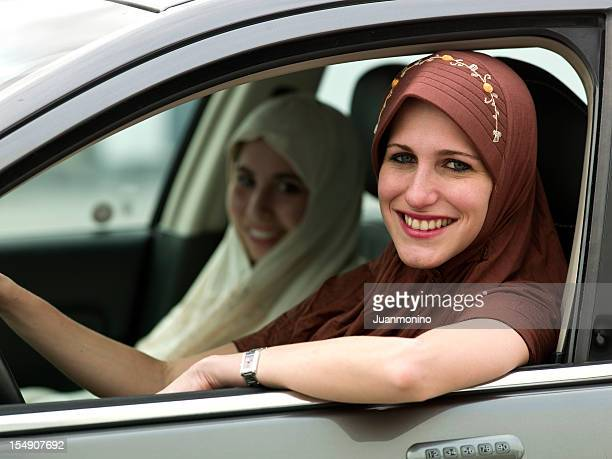 young muslim girls in a car - iranian woman stock photos and pictures