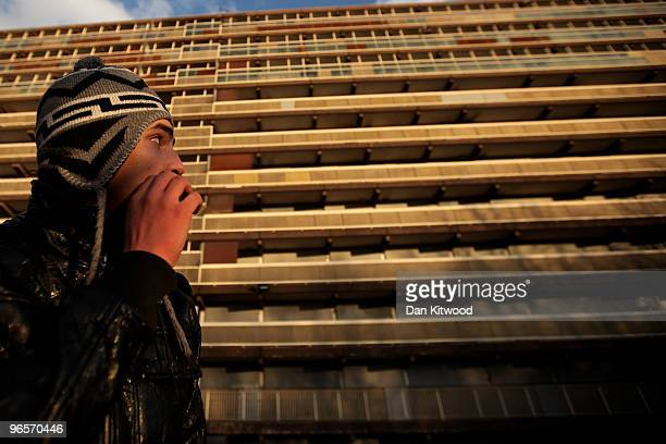 A young muslim man relaxes outside the Haygate estate in Elephant and Castle on February 10 2010 in London United Kingdom A relocation project run by...