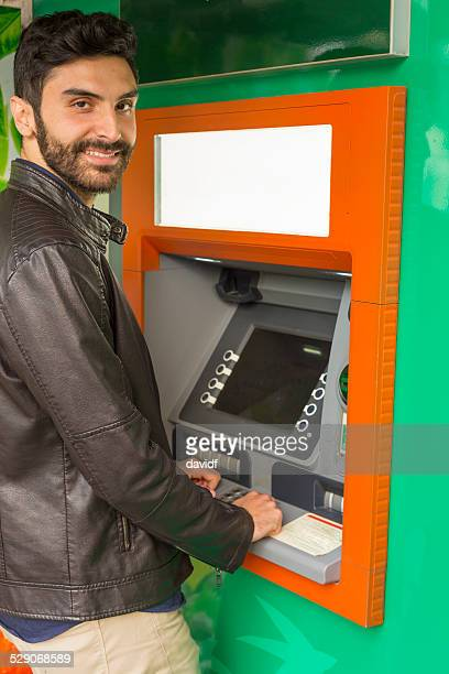 Young Muslim Man Using an ATM