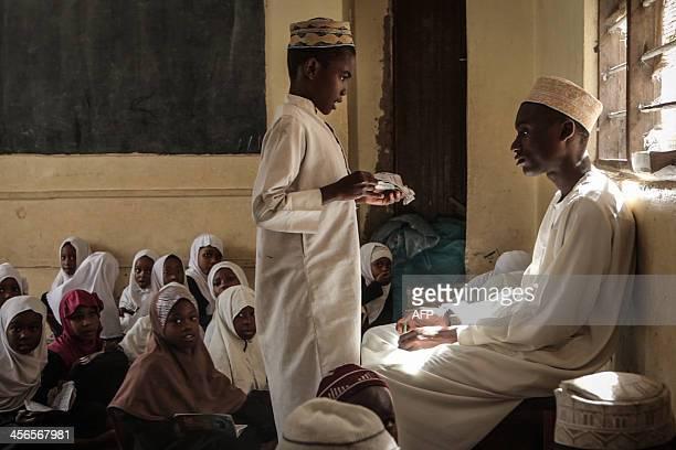 Young muslim students study at the Madrasatu Taufiq a Koranic school in Zanzibar on November 19 2013 This popular tourist paradise is facing rising...