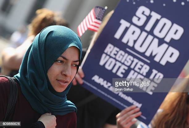 A young Muslim woman attends an event in which activists protesting against Republican US elections candidate Donald Trump urged US citizens abroad...