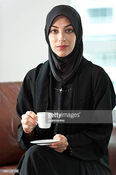 Young Muslim woman in black.