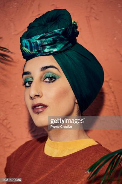 Young Muslim woman in green 70's style hijab