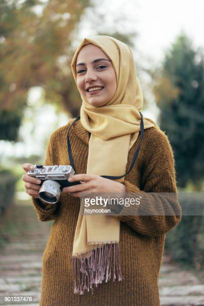Young muslim woman photographer