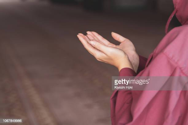 young muslim woman praying in mosque - religious celebration stock pictures, royalty-free photos & images