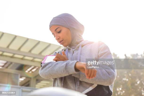 young muslim woman ready to run! - moroccan girls stock photos and pictures