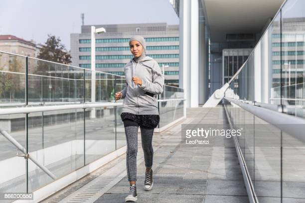 Young muslim woman ready to running in the city
