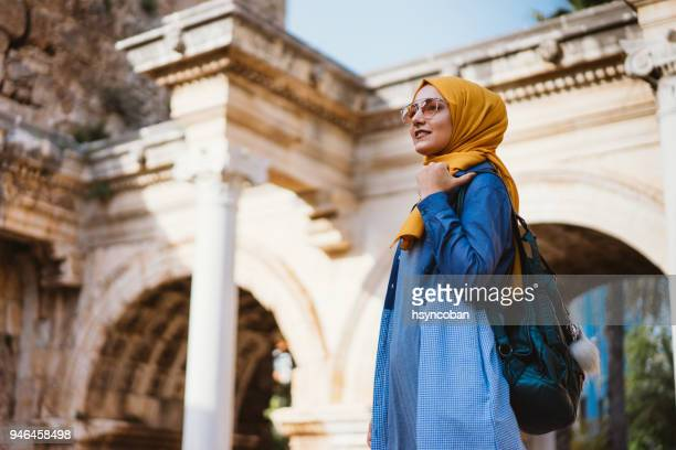 young muslim woman traveller in kaleici (old town of antalya) - middle east stock pictures, royalty-free photos & images