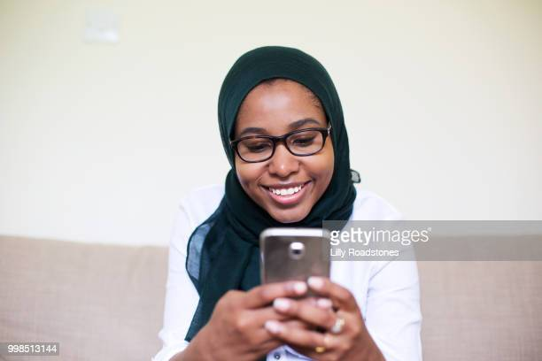 Young muslim woman using mobile phone