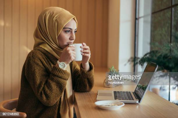 Young muslim woman working