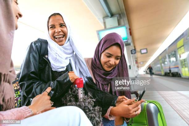 Young muslim women at train station leaving for a journey