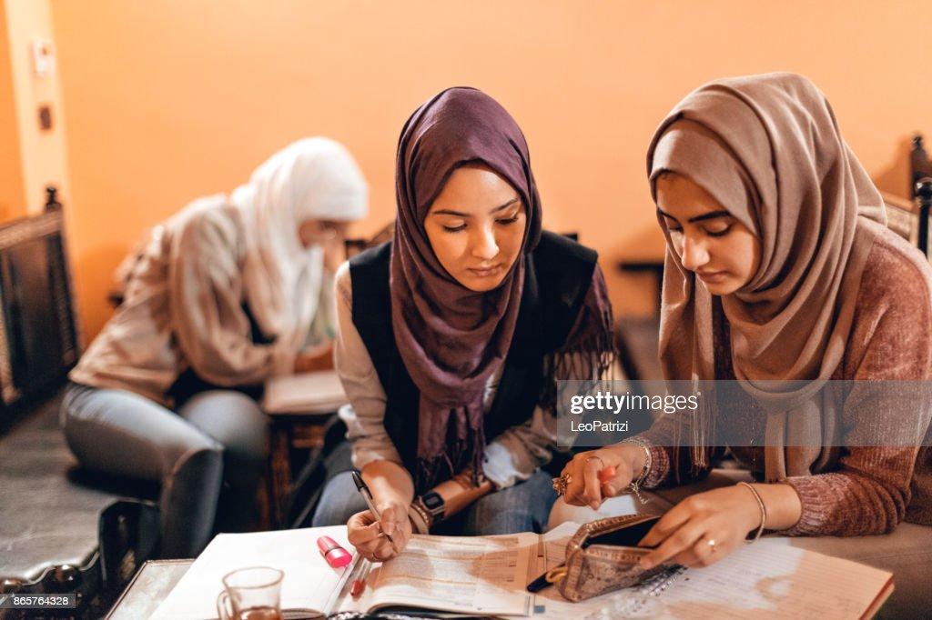 Young muslim women cooperating preparing a school exam : Stock Photo