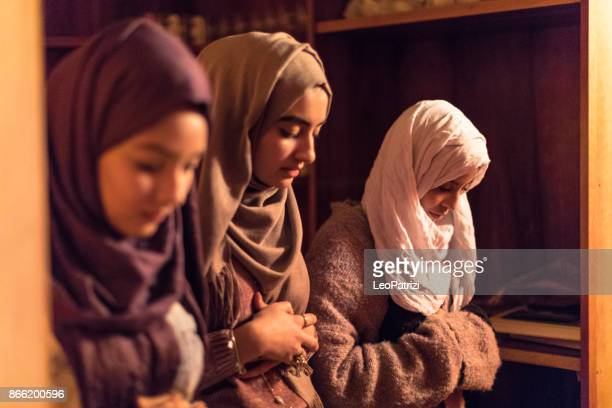 young muslim women praying - mosque stock pictures, royalty-free photos & images