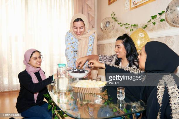 young muslim women preparing the iftar meal - ramadan decoration stock pictures, royalty-free photos & images