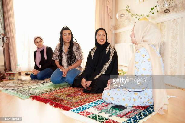 young muslim women preparing to pray - spirituality stock pictures, royalty-free photos & images