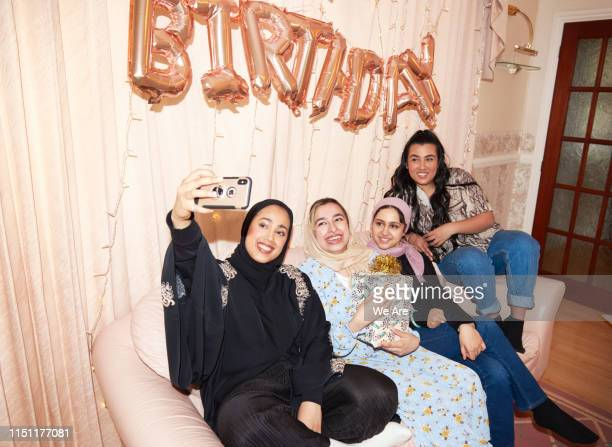 Young muslim women taking a birthday party selfie