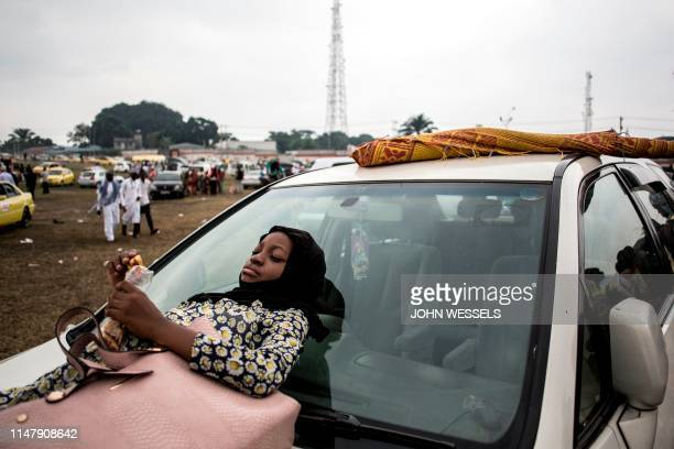 A young Muslim worshipper waits after a mass prayer to celebrate Eid alFitr on June 4 2019 at the Stade des Martyrs in Kinshasa Muslims worldwide...
