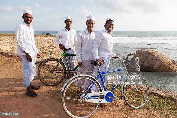 Young Muslims dressed all in white strolling in Galle´s waterfront, Galle, Southern Province, Sri Lanka, Asia. The Sri Lankan Muslims or Moors make...