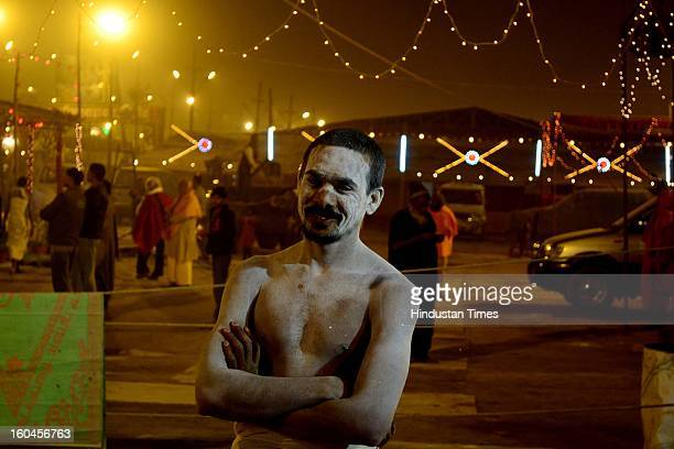 Young Naga sadhu giving a pose after an evening prayer in Bada Udaseen Akhara, in the Kumbh mela area on January 31, 2013 in Allahabad, India. The...