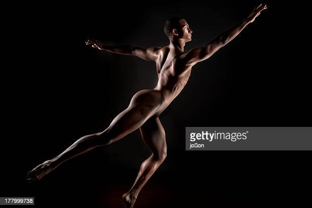 Young naked make in dander pose.