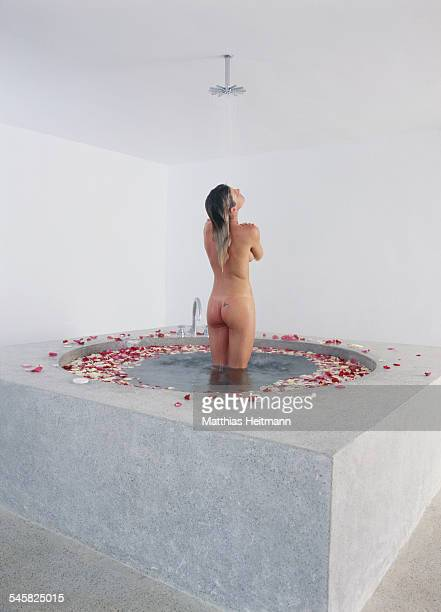 Young Naked Woman Having Shower