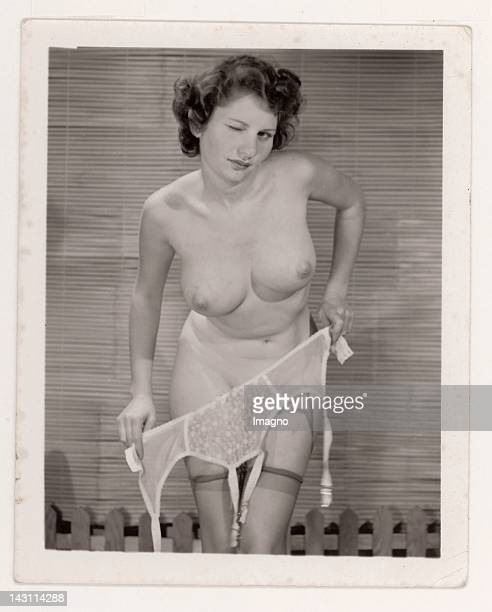 Young naked woman posing for the camera Photograph France 1950s