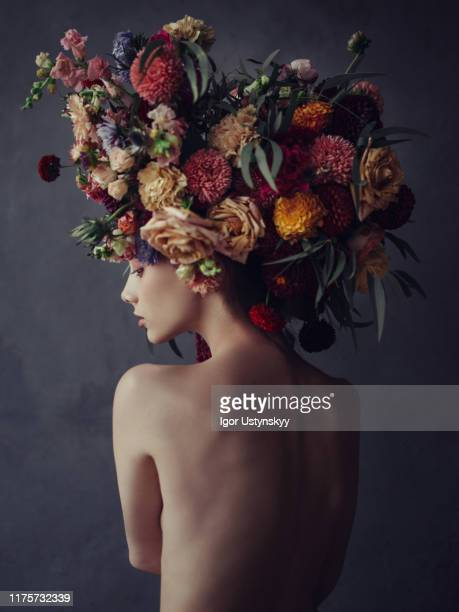 young naked woman wearing floral headdress - art bildbanksfoton och bilder