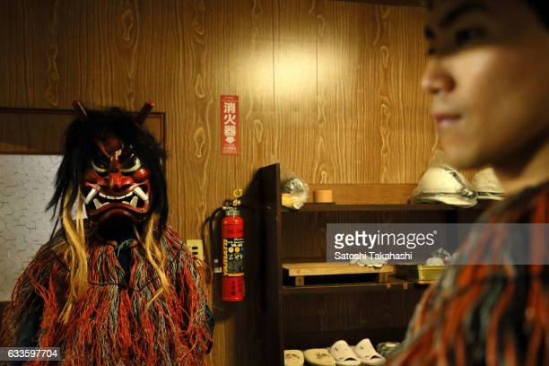 A young Namahage player who puts on a Namahage mask for the start of the Namahage festival of traditional folk event on New Year's Eve This folk...