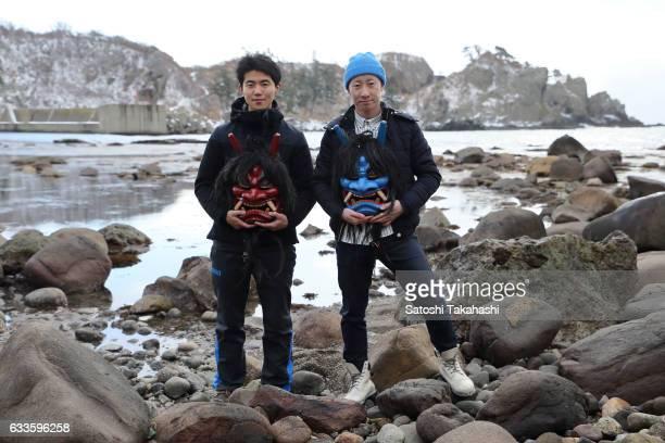 Young Namahage players Kyosuke Shinoda and Koki Suzuki who hold two different colored of Namahage masks that use the Namahage festival of traditional...