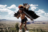 Young native american boy learns the eagle dance in grand canyon picture id467387375?s=170x170